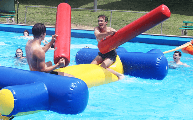 Students in pool playing water sports