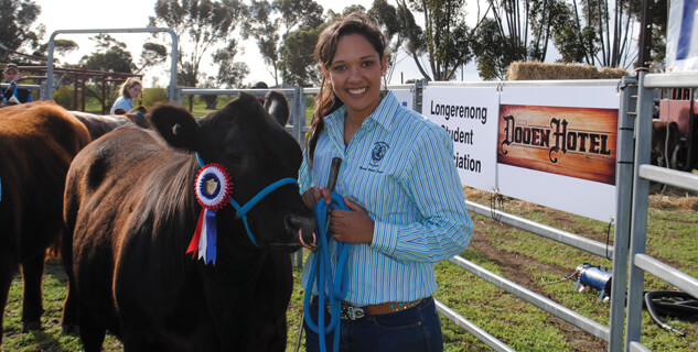 Student with award winning show steer