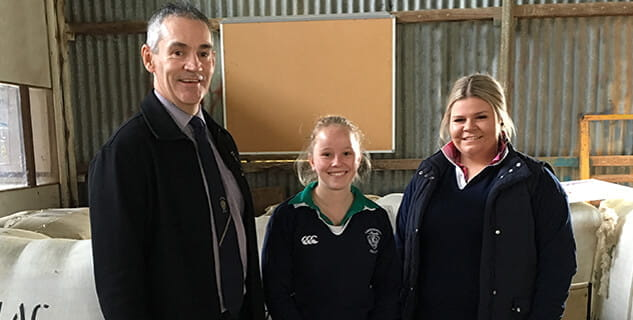 Principal of Longy College with two scholarship students