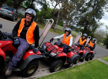 Longy College students riding red tractor bikes