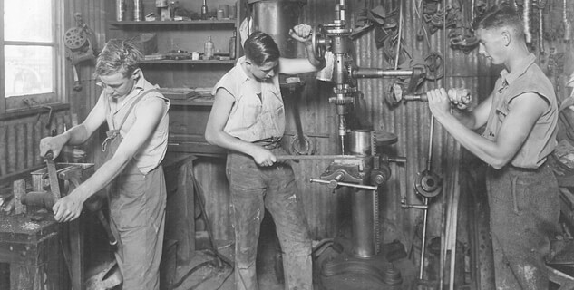 Historical black and white image of three students from Longy